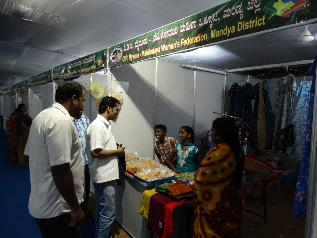 SHG members participating Mysore dasara Exhibition and Director interacting with their family member